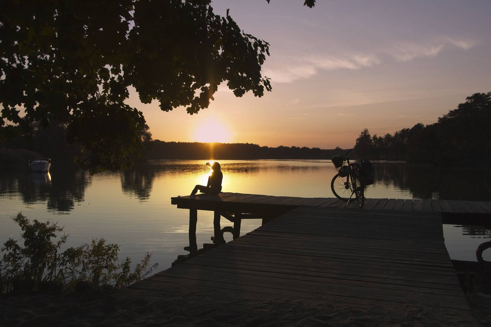 bydgoszcz poland sunset over the lake in koronowo a girl with a bike